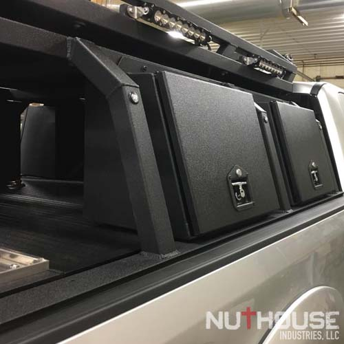 "Nuthouse Industries, Nuthouse Industries rack, Nuthouse, Hard deck, aluminum truck bed cover, Dry truck storage, secure truck bed, truck bed shelf, coiling cover, coiling truck cover, aluminum coiling cover, retracting coil cover, Removable panel hard deck, truck bed with removable cover, load bearing truck cover, aluminum truck cover, locking truck cover, secure truck bed cover, strongest truck bed cover, aluminum truck rack, aluminum bed rack, aluminum expedition truck rack, overland rack, overland truck rack, expedition truck bed rack, overland gear, roof top tent rack, RTT rack, custom truck rack, overland, overland pickup, overland pickup truck, offroad pickup, pickup truck rack, overlanding full size truck, car camping, truck camping, ladder rack, removable cross bar, tacoma truck rack, truck bed rack, expedition truck, rotopax, best overland rack, Nissan Titan, Nissan Titan overland, titan power, eezi-awn, eezi-awn roof top tent, truck vault, overland storage, action packer for car camping, overland vehicles, Nuthouse rack, Nuthouse industries, nutzo rack, AEV RAM rack, RAM truck rack, RAM 2500, RAM 1500, ford super duty rack, ford raptor, ford f150, gm rack, chevy rack, toyota overland rack, tacoma overland, expedition rack, expedition truck, off road truck rack, offroad truck rack, off road truck bed rack, mid size truck rack, mid size overland, off road rack, rotopax, 23 zero, vision x, vision x dura mini, bundaberg roof top tent, litchfield roof top tent, 23 zero roof top tent, 23 zero small tent, cvt rack, cvt tent rack, diesel overland, overland diesel, maxtrax, tred pro, traction plate, Rhino Rack, ARB, Rhino Dome mount, Rhino Rack Sunseeker mount, ARB Awning, Rhino Rack awning, 23 zero awning, 23zero awning, 23zero awning mount, truck rack awning mount, overland awning mount, expedition truck rack awning mount, zr2 overland rack, zr2 overland, colorado zr2 rack, Chevy zr2 overland, zr2 off road, zr2 truck rack, zr2 truck, diesel zr2, diesel overland, canyon overland rack, gmc canyon rack, colorado/canyon truck, zr2 expedition rack, diesel expedition truck, 2.8 duramax overland, mini duramax offroad truckmini max overland, expedition zr2, overland zr2, best overland rack zr2, chevy off road, chevy overland, gmc overland, gmc canyon rack, zr2 bed rack, mid size truck rack, racks for toyota tacoma, tacoma overland gear, overland tacoma, tacoma expedition rack, toyota overland, toyota expedition gear, toyota expedition rack, mid size truck rack, Ford Super duty, Alumaduty, F250, Ford Super duty rack, Ford super duty roof top tent rack, ford super duty rtt rack, f250 rack, f250 roof top tent rack, f250 rtt rack, f250 overland, ford super duty overland, alumaduty overland, Spitz lift, spare tire lift, overlanding rig with crane, overlanding rig with boom, easy tire lift, pro eagle jack, race jack mount, power tank, power tank mount, baja design, baja design light bar, baja onx 6, baja design s2 pro, baja design onx six, baja design s8, baja design 40"" light bar, baja design racer light bar, max tie down, l track, flush l track, airplane track, Nutshell storage pods, Storage on truck rack, aluminum storage boxes, truck rack storage, gear locker on rack, recovery gear storage for overlanding, overland gear storage, camp gear storage, recovery gear for truck rack,"