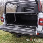 Hard deck, aluminum truck bed cover, Dry truck storage, secure truck bed, truck bed shelf, coiling cover, coiling truck cover, aluminum coiling cover, retracting coil cover, Removable panel hard deck, truck bed with removable cover, load bearing truck cover, aluminum truck cover, locking truck cover, secure truck bed cover, strongest truck bed cover, headache rack, cargo rack, truck bed rack with cover, Nuthouse Industries, Nuthouse Industries rack, Nuthouse, aluminum truck rack, aluminum bed rack, aluminum expedition truck rack, overland rack, overland truck rack, expedition truck bed rack, overland gear, roof top tent rack, RTT rack, custom truck rack, overland, overland pickup, overland pickup truck, offroad pickup, pickup truck rack, overlanding full size truck, car camping, truck camping, ladder rack, removable cross bar, tacoma truck rack, truck bed rack, expedition truck, rotopax, best overland rack, truck vault, overland storage, action packer for car camping, overland vehicles, Nuthouse rack, Nuthouse industries, nutzo rack, ford super duty rack, ford raptor, ford f150, gm rack, chevy rack, colorado bed rack, tacoma bed rack, ford bed rack, toyota overland rack, tacoma overland, expedition rack, expedition truck, off road truck rack, offroad truck , rack, off road truck bed rack, mid size truck rack, mid size overland, off road rack, rotopax, vision x, vision x dura mini, cvt rack, cvt tent rack, diesel overland, overland diesel, maxtrax, tred pro, traction plate, , truck rack awning mount, overland awning mount, expedition truck rack awning mount, 23 Zero rack, chase rack, best overlanding rack, nuthouse industries, nuthouse industries rack, nutzo rack, aluminum rack, aluminum overlanding rack, aluminum rtt rack, trailer tent, Off road expedition bed rack, off road bed rack, off road truck bed rack, adventure rack, bed cage, aluminum storage boxes, universal mounting plate, made in the USA, American made, east coast overlanding, Rotopax, rotopax gas can, rotopax, water can, rotopax storage, rotopax fuel, built in the USA, Spare tire shelf, store extra gear on Rambox, overland rack extra gear, Jeep Truck, Jeep Gladiator, Jeep JT, JT, Jeep truck rack, Jeep Gladiator Rack, Jeep JT Rack, JT rack, Jeep truck expedition rack, jeep gladiator expedition rack, jeep jt expedition rack, JT expedition rack, Jeep truck bed rack, jeep gladiator truck bed rack, Jeep JT truck bed rack, JT truck bed rack, Jeep adventure rack, Jeep Gladiator adventure rack, jeep jt adventure rack, jeep truck adventure rack, jeep truck bed cage, jeep gladiator bed cage, jeep jt bed cage, jt bed cage, jeep truck rtt rack, Jeep gladiator RTT rack, Jeep JT RTT rack, JT RTT rack, Jeep Expedition truck, jeep truck overlanding, jeep gladiator overland, jeep jt overland, JT overland, 419 0verland, pick and shovel overland, jeep truck chase rack, jeep gladiator chase rack, jeep jt chase rack, jeep truck ladder rack, jeep gladiator ladder rack, jeep jt ladder rack, Gladiator expedition rack, gladiator truck rack, gladiator adventure rack, gladiator bed rack, gladiator bed cage, gladiator overland, gladiator chase rack, gladiator ladder rack, gladiator bed cage, best rack for gladiator, best overlanding rack, best expedition rack for jeep gladiator, Chase rack, Jeep chase rack, gladiator chase rack, jt chase rack, adventure rack, jeep rack, jt rack, gladiator rack, bed rack, aluminum bed rack, aluminum chase rack, maxtrax, rotopax, hi-lift, hi-lift jack, Nuthouse Industries, expedition bed rack, best jt rack, best gladiator rack, jt tire carrier, gladiator tire carrier, tire carrier rack,